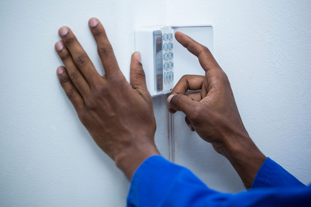 man fixing a security device