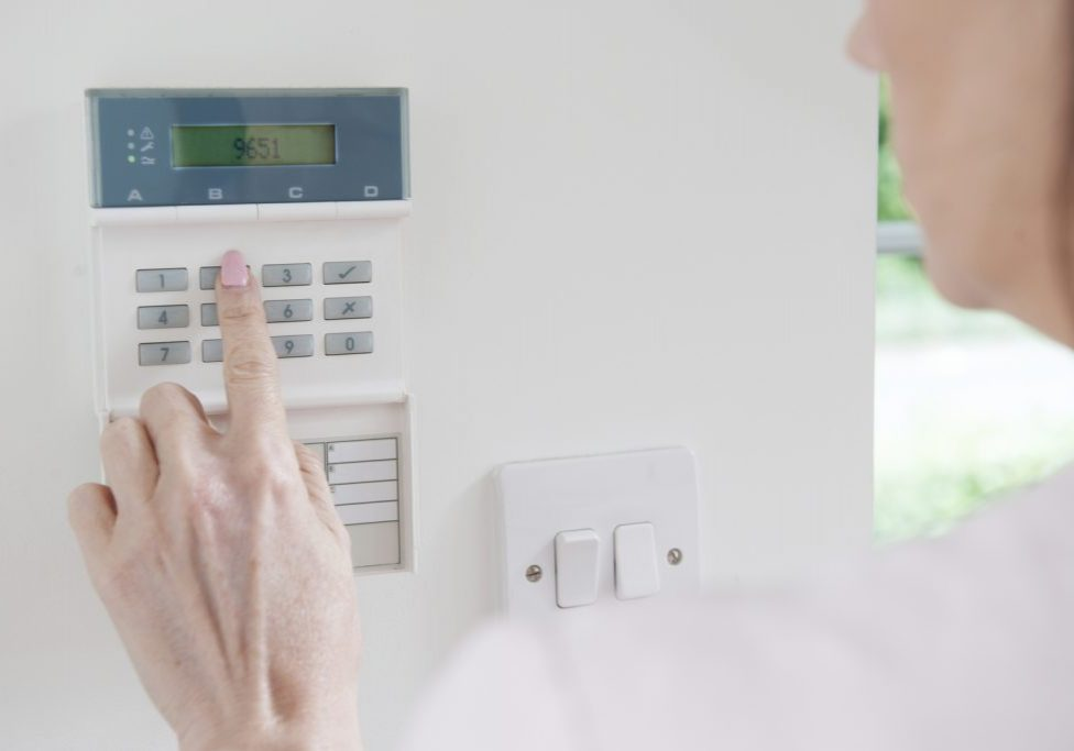 woman using a security device